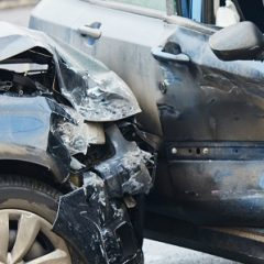 Car crash accident on street with damaged automobiles after collision